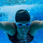 Female swimmer diving underwater in swimming pool